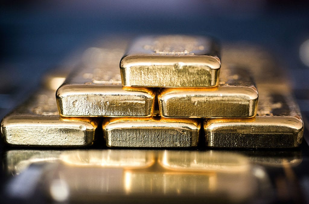 Gold slides nearly 2% on dollar rally, IMF silver lining