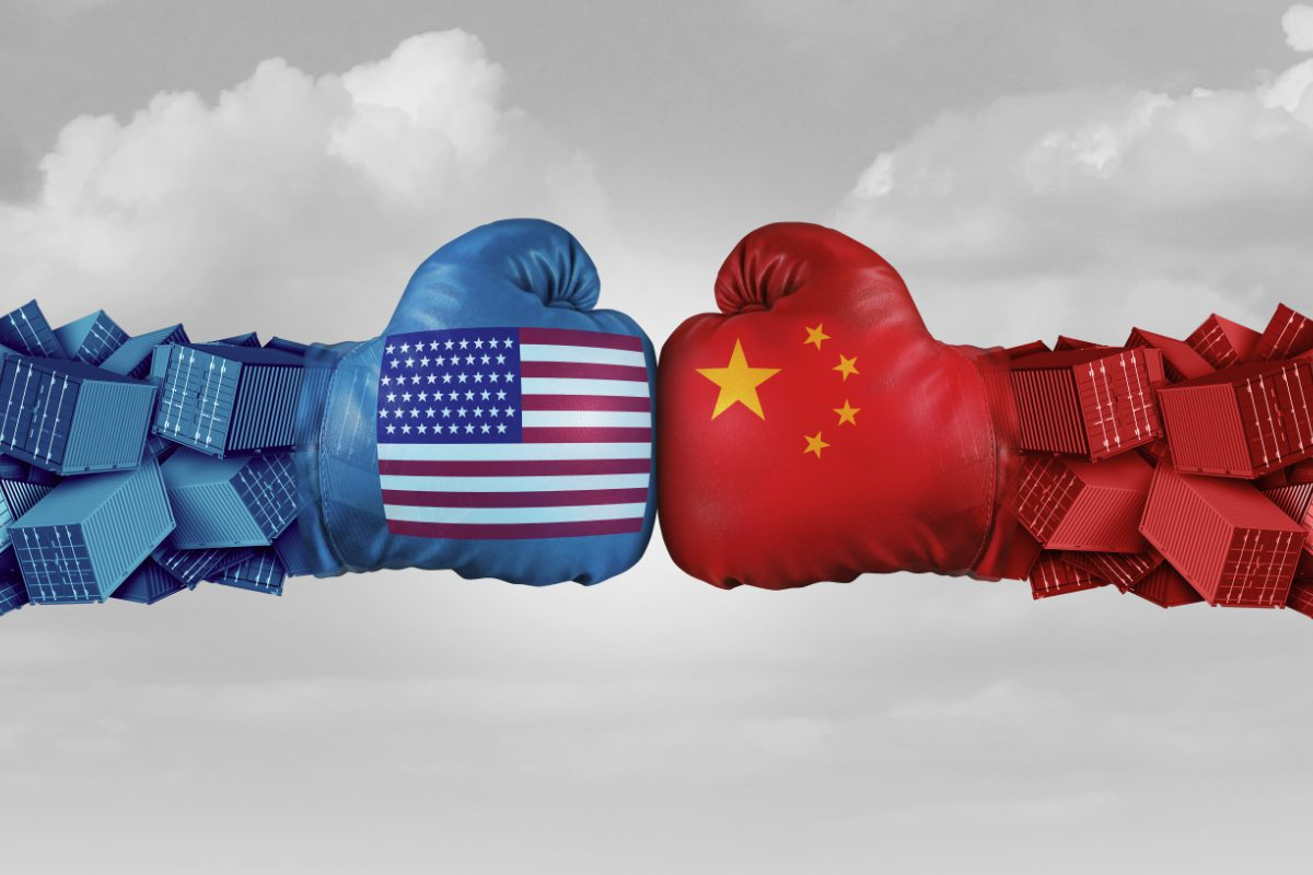Morgan Stanley warns of Trade War Implications depicted here as American Flag boxing gloves punching into contact with opposing China flag boxing glove